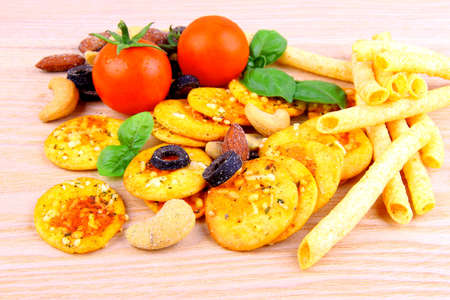 mediterrean: Mediterrean snack, pizza crackers, dried olives, nuts, tomatoes, close up Stock Photo