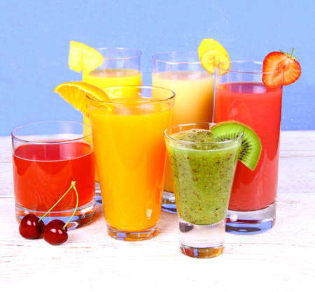 Fruit juices from kiwi, cherry, orange, strawberry, banana, pineapple, vertical photo