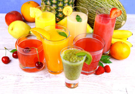 Fruit juice with kiwi, cherry, melon, tangerine, pear, apricot, horizontal photo