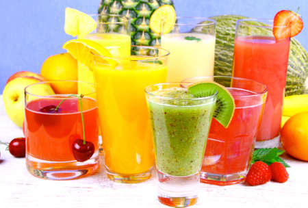Fruit juice with kiwi, cherry, melon, tangerine, pear and apricot, close up photo