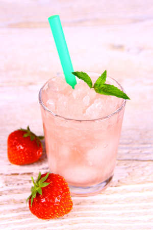 slush: Strawberry slush in glass with straw and berries, close up Stock Photo