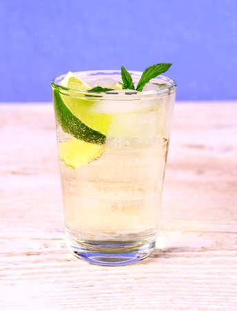hugo: Elderberry cocktail on blue background, close up