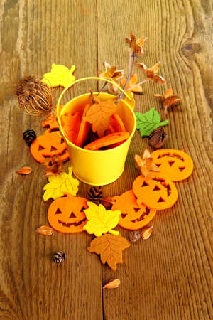 Yellow bucket and Halloween Decoration, vertical photo