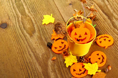 Yellow bucket and Halloween, autumn deco and writing space, close up photo