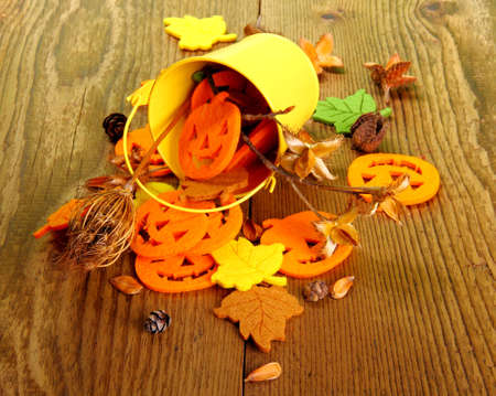 Yellow bucket and Halloween, autumn deco, close up photo