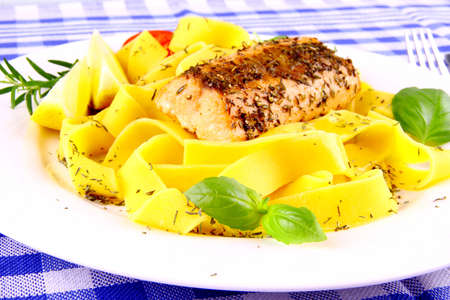 Grilled salmon fillet and taglateli, lemon with basil, horizontal photo