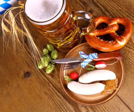 Oktoberfest menu - beer, white sausage, pretzel and radish, top view photo