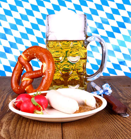 White sausage, pretzel, beer, radish with mustard, close up photo