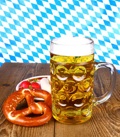 Beer with pretzel, white sausage and radish, close up photo