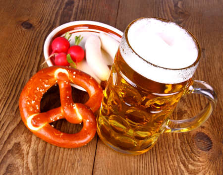 Beer with pretzel, white sausage and radish 스톡 콘텐츠