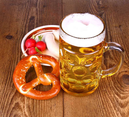 Beer and pretzel, radish and white sausage, close up photo