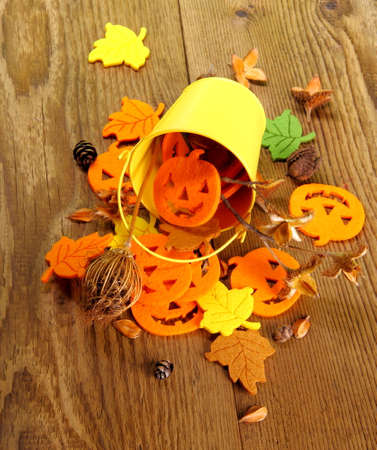 Yellow bucket with Halloween, autumn deco and writing space, top view photo