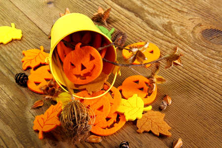 Yellow bucket and Halloween, autumn deco with writing space, close up photo