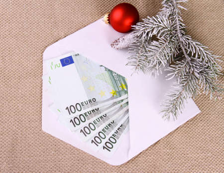 Christmas bonus as five hundred euro money in envelope, top view photo