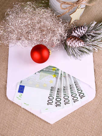 christmas bonus: Christmas bonus as five hundred euro in envelope and decor, top view Stock Photo