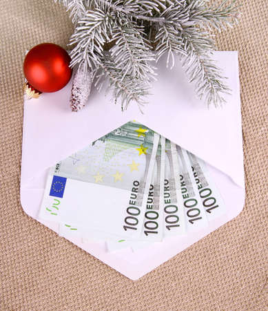 Christmas bonus - five hundred euro in envelope and decor, top view photo