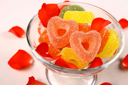 sours: Colorful jelly candies in heart shape with flowers leaves, close up