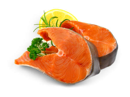 Two salmon steaks with spice and lemon, isolated photo