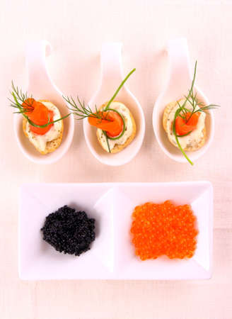 Smoked Lachsrollchen on white bread with caviar photo