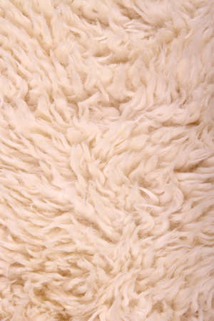 White lambskin as background, vertical and close up Stock Photo
