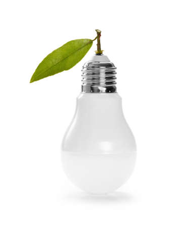 LED lamp with green leaf, ECO energy concept, close up photo