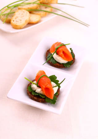 Smoked salmon roll on pumpernickel bread and remoulade, top view photo