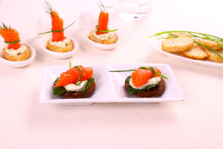 Smoked salmon roll on pumpernickel bread with remoulade, horizontal photo
