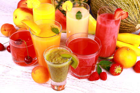 Fruit juice with kiwi, apricot, cherry, watermelon, tangerine, pear, top view photo