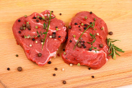 beef meat: Two juicy beef steak with spices and herbs, top view