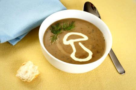 Precious mushroom cream soup with bread, close up photo