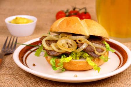 semmel: Ochsen semmel, grilled beef with onion rings in bun, mustard, beer