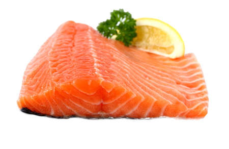 lemon wedge: Raw, red salmon fillet with lemon wedge, isolated Stock Photo