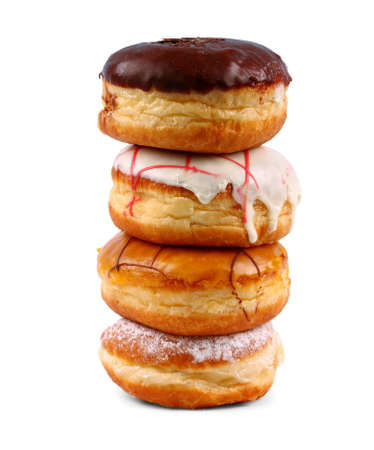 Four delicious, assorted german donuts as tower, isolated photo