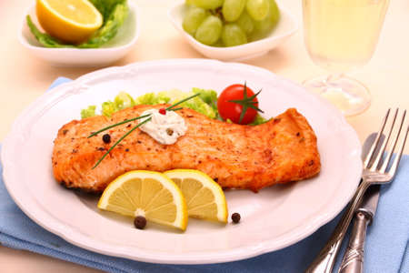 Grilled salmon fillet, sauce and vegetables, horizontal photo