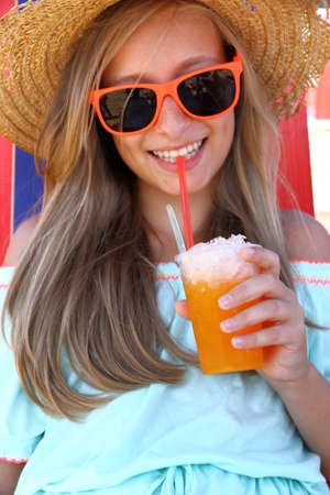 slush: Beautiful girl in sunglasses and slush on beach, vertical Stock Photo