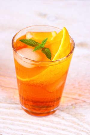 Orange cocktail on white wooden background, close up Stock Photo