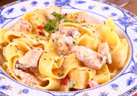 salmon fillet with tagliatelle, cream sauce and herbs photo