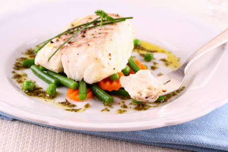 Cod Fillet with green beans, peas, parsley, olive oil Stockfoto