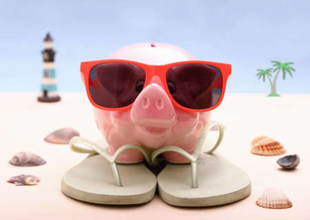Funny Piggy bank with sunglasses, holiday background, close up photo