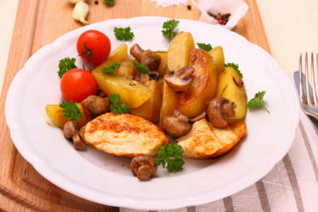 Chicken fillet, mushroom, rosemary potatoes, top view photo