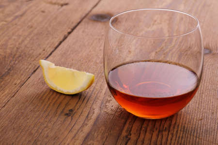 drunks: Luxury Cognac in decorative glass on wood with lemon