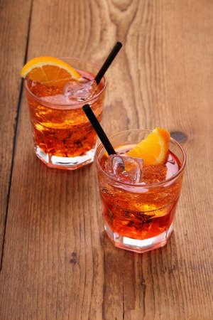 Spritz aperitif, two orange cocktail with ice cubes, top view