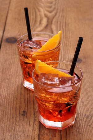 Spritz aperitif, two orange cocktail, ice cubes, close up