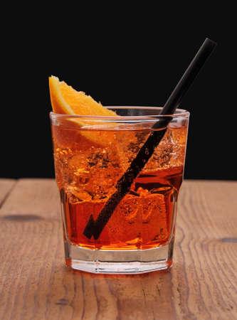 Spritz aperitif, italian orange cocktail and ice cubes, close up