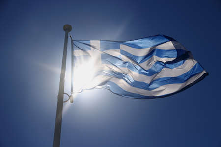 emborio: Greece flag on blue sky, backlit subject, contre-jour Stock Photo