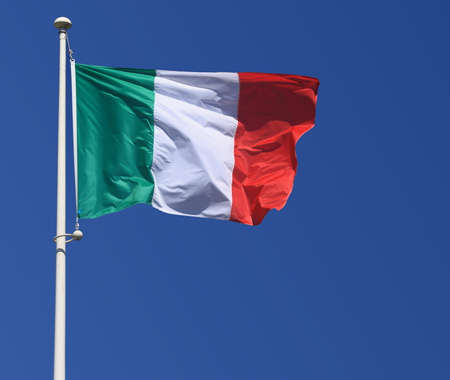 Italy flag on blue sky, close up