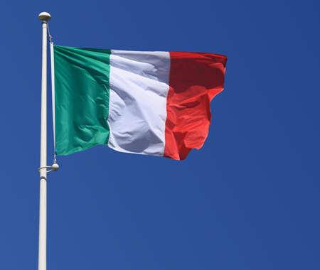 Italy flag on blue sky, close up
