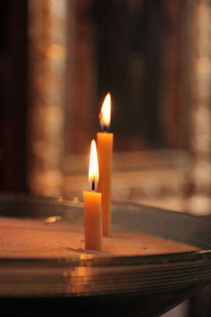 Two candles in church as background photo