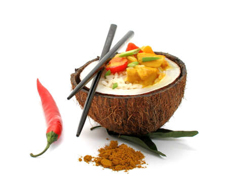 Coconut, rice and curry chicken on white background, close up