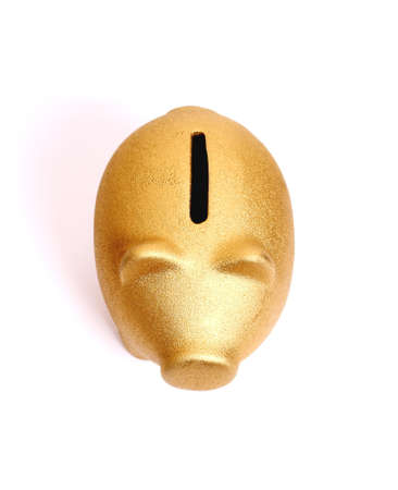 Golden piggy bank from top view, isolated